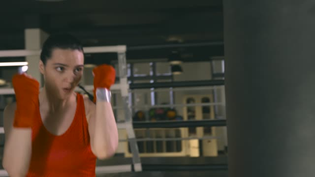 Woman training in boxing club video