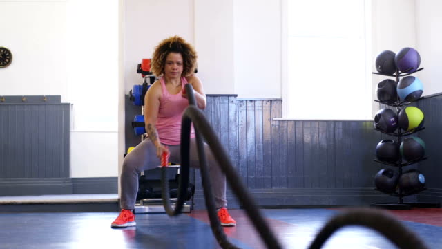 Woman Training in Gym with Battle Ropes video