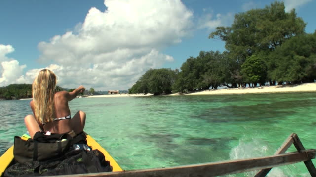 Woman traveling by boat towards Indonesian fishermen's Island video