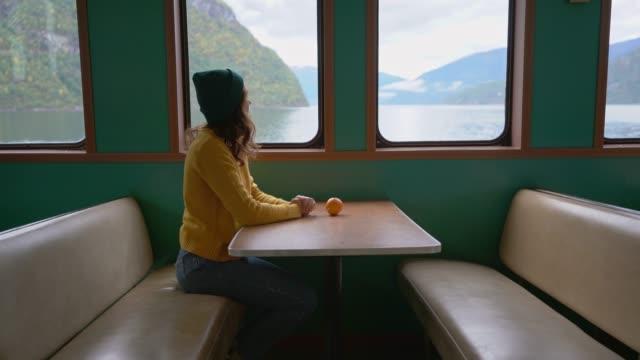 vídeos de stock e filmes b-roll de woman traveling by ferry in norway - países nórdicos