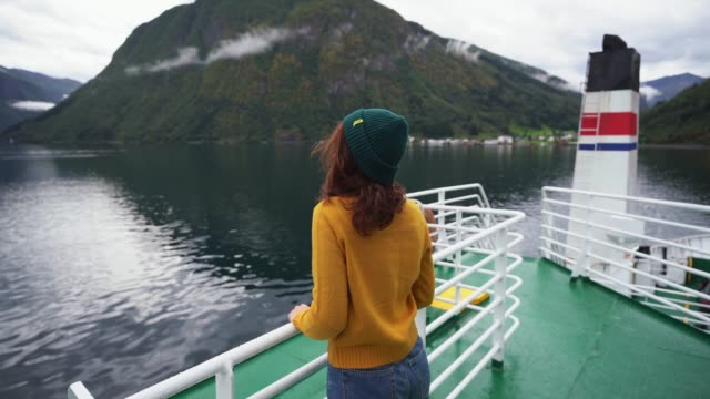 Woman traveling by ferry in Norway