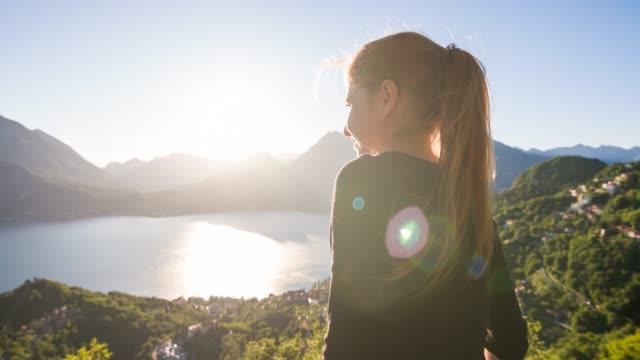 Woman traveling Italy, enjoying breathtaking view of lake Como