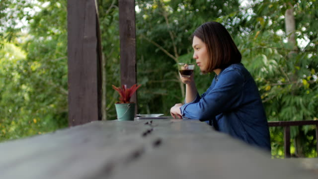Woman traveller take a coffee at outdoors cafe in nature video