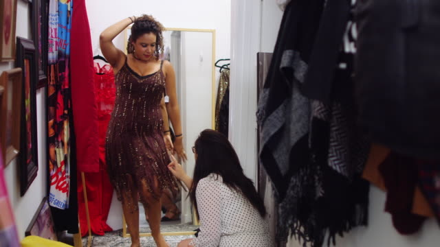 Woman Trying on Clothes in Vintage Store Showing Off to Friend video