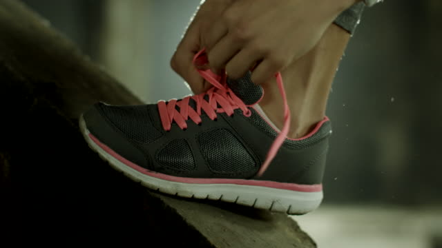 Woman tying her exercise shoes video