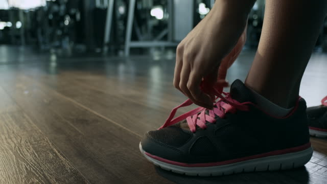 Woman tying shoelaces video