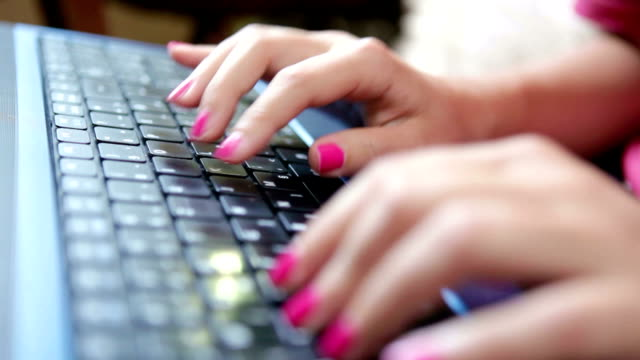 Woman typing on a keyboard close up video video