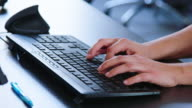 istock Woman typing on computer keyboard 1201224058