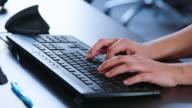 istock Woman typing on computer keyboard 1201224058