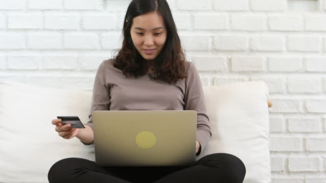 Woman Typing On Her Laptop At home video