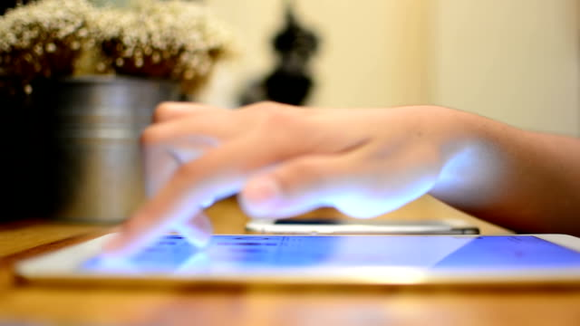 Woman Typing on Tablet PC video