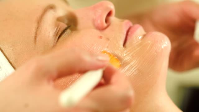 Woman under facial spa procedure video