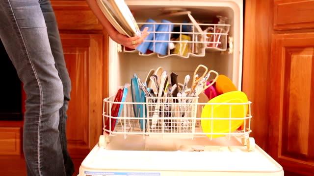 Woman Unloading a Dishwasher video