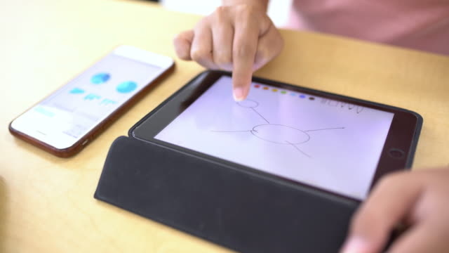 Woman use a smart phone and tablet in the library video