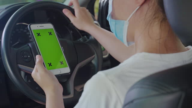 Woman use chroma key with smart phone