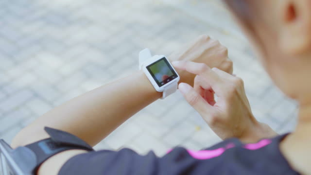 vídeos de stock e filmes b-roll de woman use of smart watch and cellphone - watch