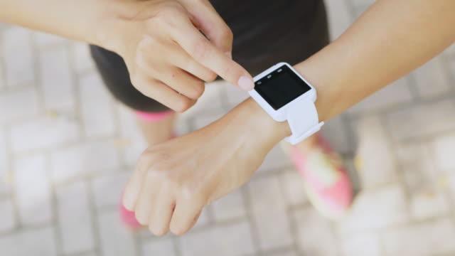 woman use of smart watch and cellphone - wellness filmów i materiałów b-roll