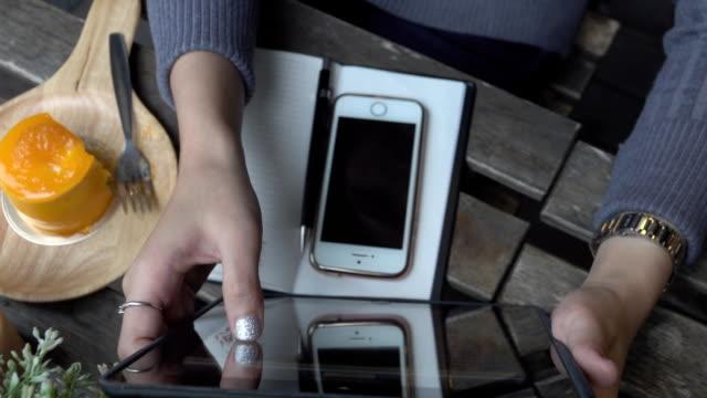 Woman use tablet overhead angle video
