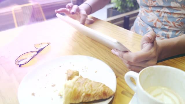 Woman using a digital tablet. video