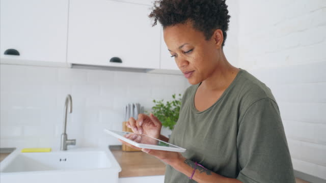 Woman using a digital tablet. video