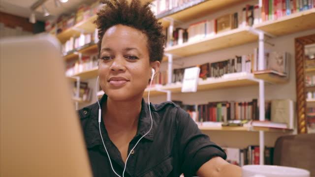 Woman using a laptop.