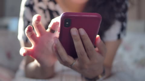 A woman using a phone at home indoor An woman using a phone at home indoor, close-up shot of hands using a smartphone- texting and working. choosing stock videos & royalty-free footage