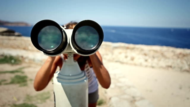 Woman using binoculars video