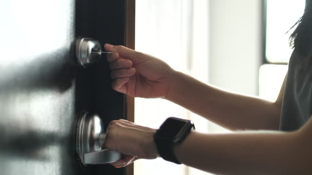 woman using cardkey for opening the door - hotel checkin video stock e b–roll