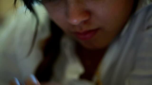 Woman using digital tablet computer video