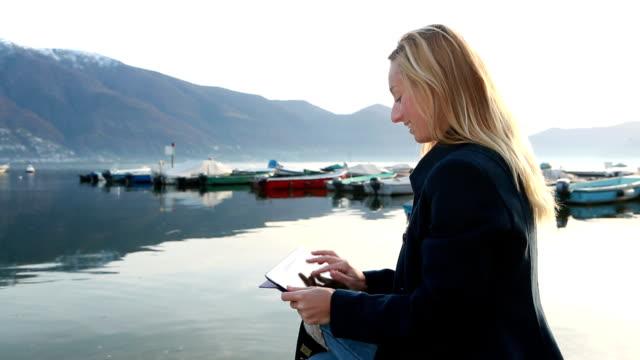 Woman using digital tablet video
