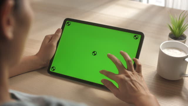 Woman using Digital tablet with Green screen Chroma Key,Digital Tablet,Using Digital Tablet, Woman using Digital tablet with Green screen ipad stock videos & royalty-free footage