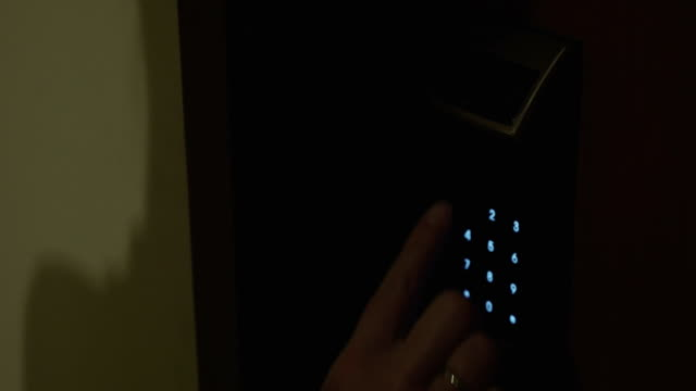 Woman using electronic code lock to open hotel room video