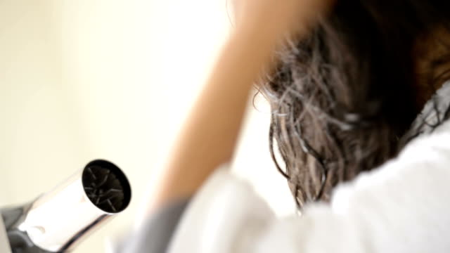 Woman Using Hairdryer video