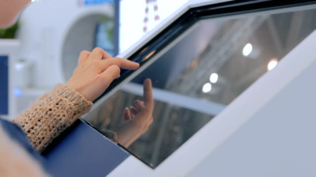 woman using interactive touchscreen display at urban show - stand video stock e b–roll