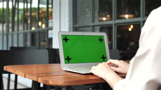 Woman using Laptop green screen