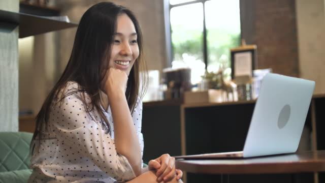 Woman Using Laptop in coffee shop video