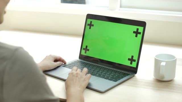 Woman using Laptop with Blank Display Chroma key