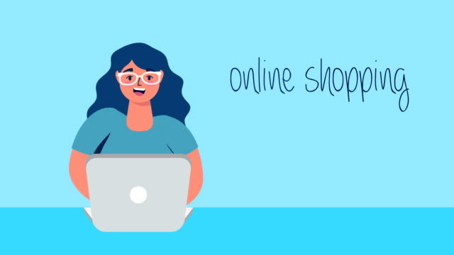 woman using laptop with cart online shopping video