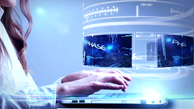 Woman using laptop with computing hologram interface video
