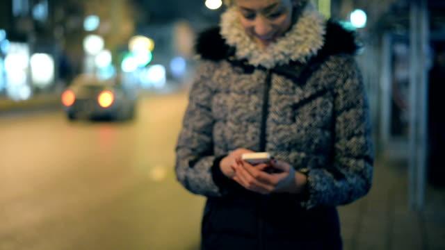 Woman using phone video