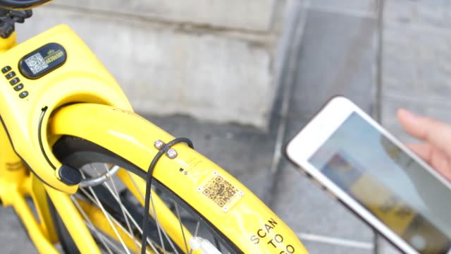 Woman using Rental Bicycle iot,smart internet car rental stock videos & royalty-free footage