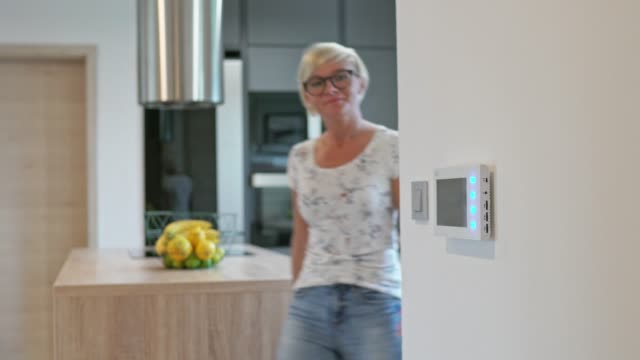 Woman using smart home features video