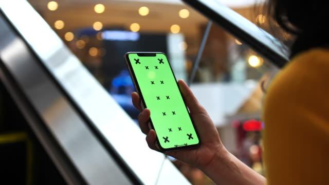 Woman Using Smart phone green screen