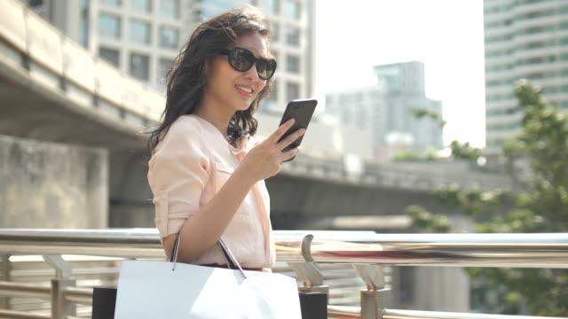 Video Woman using Smart phone shopping