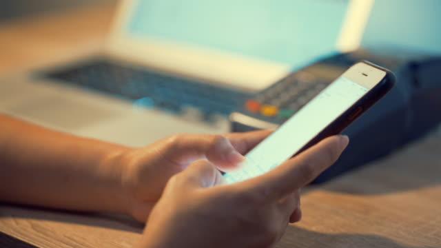 Woman using smart phone Woman using smart phone password stock videos & royalty-free footage