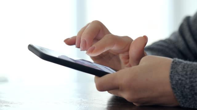 Woman using smart phone. video