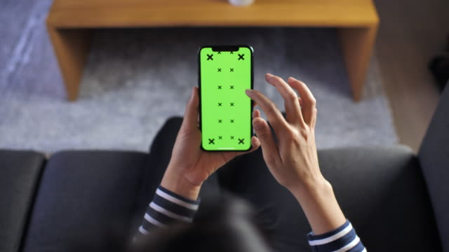 Woman Using Smart phone with Green screen, POV Woman Using Smart phone with Green screen, POV, iPhone X iphone stock videos & royalty-free footage