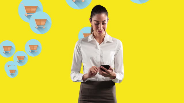 Woman using smartphone against shopping cart icons on yellow background