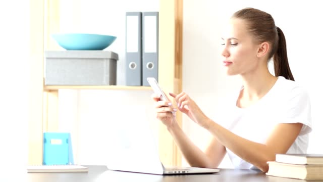 Woman Using Smartphone Applications at Work in Office video