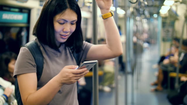 Woman using smartphone in metro transportation Woman using smartphone in metro transportation 4K(UHD) web browser stock videos & royalty-free footage
